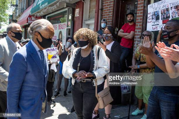 Al Sharpton joins Gwen Carr the mother of police victim Eric Garner at the scene of his death six years ago to call for firstdegree murder charges...