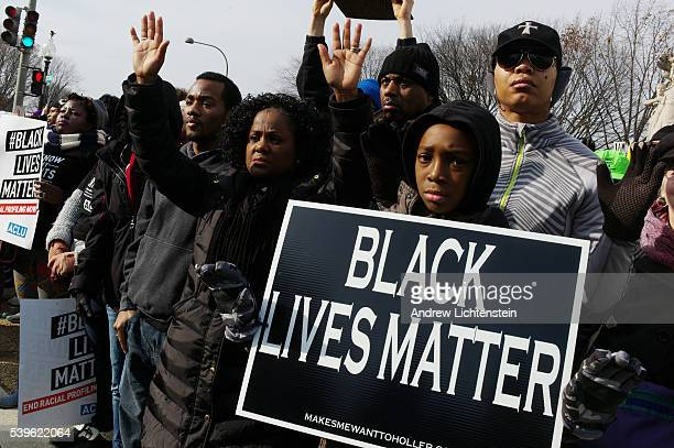 Al Sharpton leads a Justice for All rally in downtown Washington DC to protest against police brutality and the recent Michael Brown and Eric Garner...