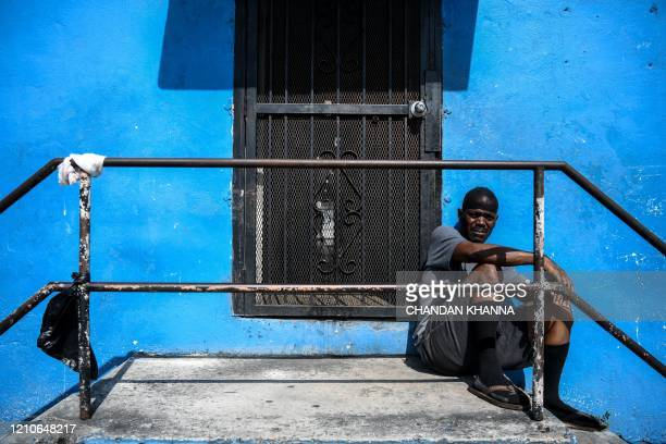 Al sits outside his house in a low income mostly AfricanAmerican neighbourhood in Miami on April 19 2020 Al was fired form his job last month due to...