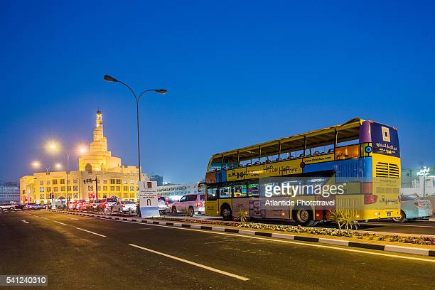 Al Souk district, touristic bus and the Fanar Qatar Islamic Cultural Center with the spiral minaret