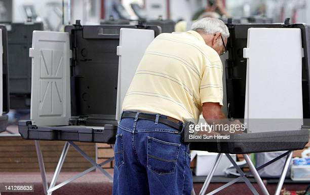 Al Tapper votes at the Francis Collins Fitness Center Tuesday March 13 in Gulfport Mississippi