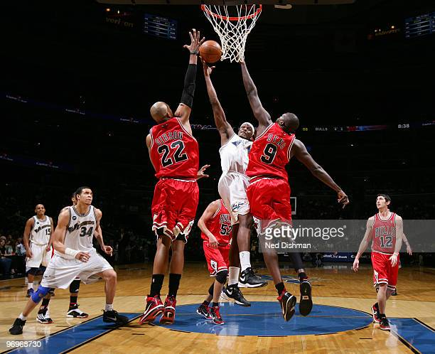 Al Thornton of the Washington Wizards shoots against Taj Gibson and Luol Deng of the Chicago Bulls at the Verizon Center on February 22 2010 in...