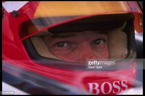 Al Unser Jr of the United States looks on during the Indycar Molson Indy in Vancouver British Columbia