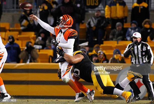 Al Woods of the Pittsburgh Steelers pressures Andy Dalton of the Cincinnati Bengals during the game on December 15, 2013 at Heinz Field in...