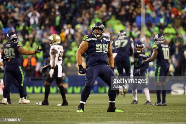 Al Woods of the Seattle Seahawks reacts to a defensive stop during the second half against the New Orleans Saints at Lumen Field on October 25, 2021...