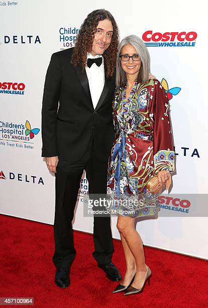 Al Yankovic and his wife attend the 2014 Children's Hospital Los Angeles Gala Noche De Ninos at LA Live Event Deck on October 11 2014 in Los Angeles...