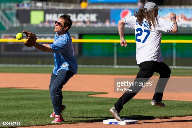 Al Yankovic runs past Johnny Knoxville during the Big Slick Celebrity Weekend benefitting Children's Mercy Hospital of Kansas City on June 23 2017 in...