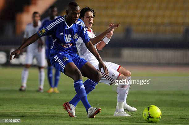 Al Zamalek player Ibrahim Salah vies for the ball with TB Mazimbe player Stopila Sunzu during a CAF Confederation Cup match at the military academy...