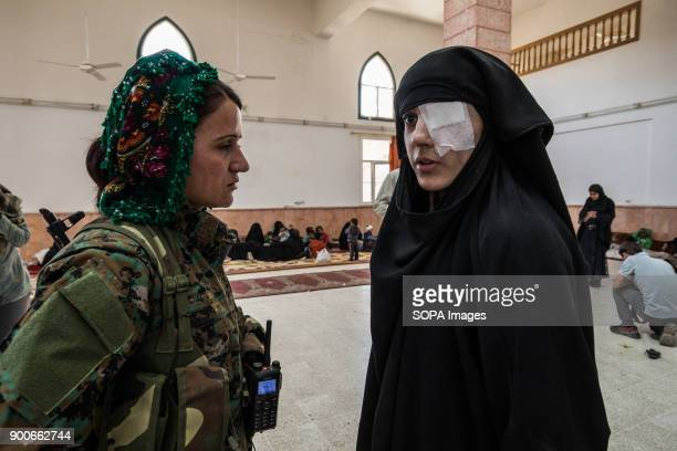 Ala Hama who was just rescued from Raqqa is talking to a YPJ soldat She lost one of her eyes while she was in the balcony of her house and an...
