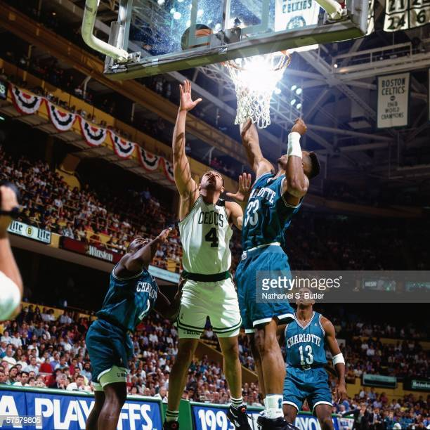 Alaa Abdelnaby of the Boston Celtics shoots a layup against Alonzo Mourning of the Charlotte Hornets during game one of the Eastern Conference...