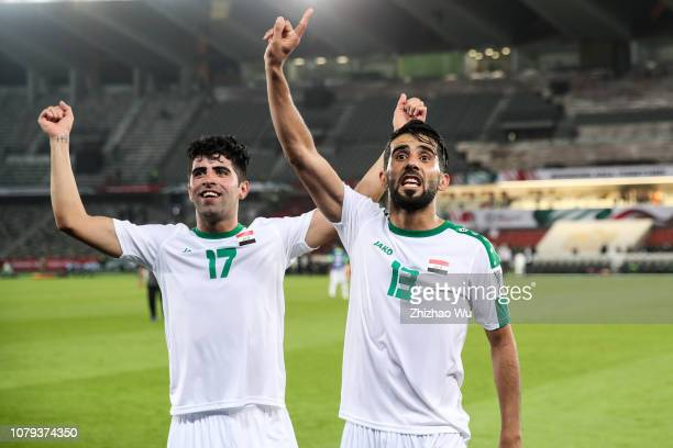 Alaa Ali Mhawi and Bashar Resan Bonyan of Iraq celebrates the victory with fans after the AFC Asian Cup Group D match between Iraq and Vietnam at...