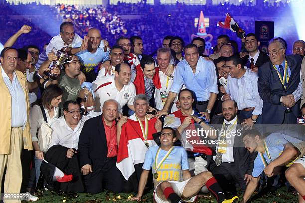 Alaa and Gamal Mubarak sons of Egyptian President Hosni Mubarak celebrate with their national team the trophy after winning their football final...