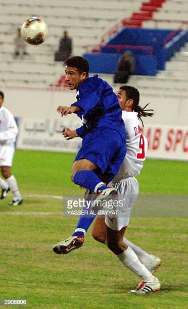 Alaa Jabr of Iraq's alTalaba club L fights for the ball against Kuwait's Hussein Ali Hakem of alKuwait club during their Arab Clubs Championship...
