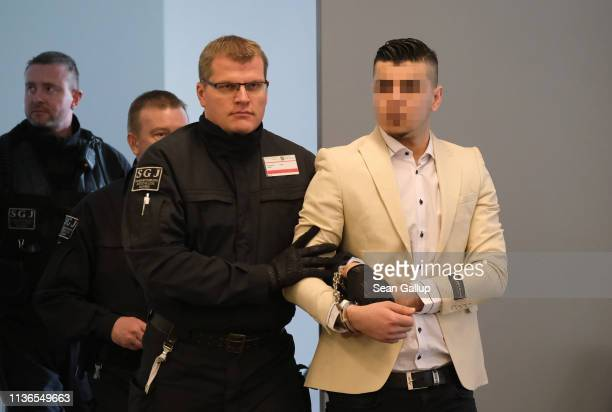 Alaa S arrives in court for the first day of his trial for the possible murder of a German man in Chemnitz last year on March 18 2019 in Dresden...