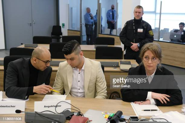 Alaa S sits with a translator and Ricarda Lang one of his lawyers as he arrives in court for the first day of his trial for the possible murder of a...