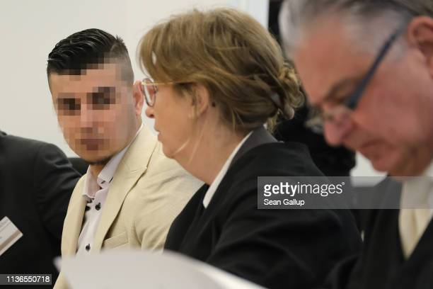 Alaa S sits with his lawyers Ricarda Lang and Frank Wilhelm Drücke as he arrives in court for the first day of his trial for the possible murder of a...