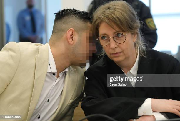 Alaa S speaks with Ricarda Lang one of his lawyers as he arrives in court for the first day of his trial for the possible murder of a German man in...