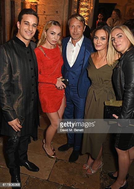Alaa Safi, Katrina Durden, Mads Mikkelsen, Zara Phythian and guest attend Marvel Studios and British GQ hosted reception in The Cloisters at...