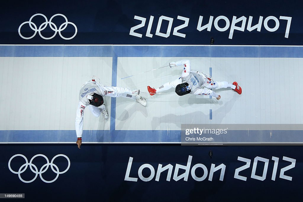 Alaaeldin Abouelkassem of Egypt (L) competes against Byungchul Choi of Korea in the Men's Foil Individual Semifinal on Day 4 of the London 2012 Olympic Games at ExCeL on July 31, 2012 in London, England.