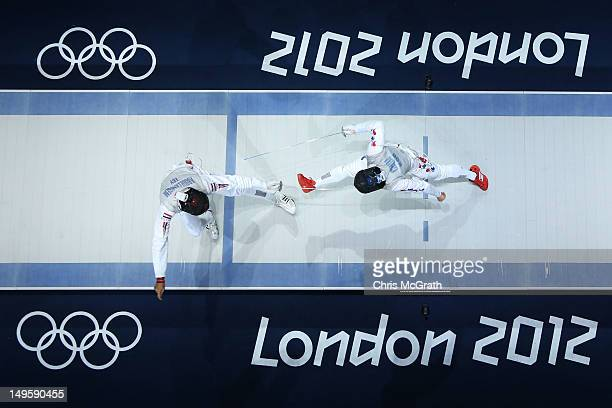 Alaaeldin Abouelkassem of Egypt competes against Byungchul Choi of Korea in the Men's Foil Individual Semifinal on Day 4 of the London 2012 Olympic...