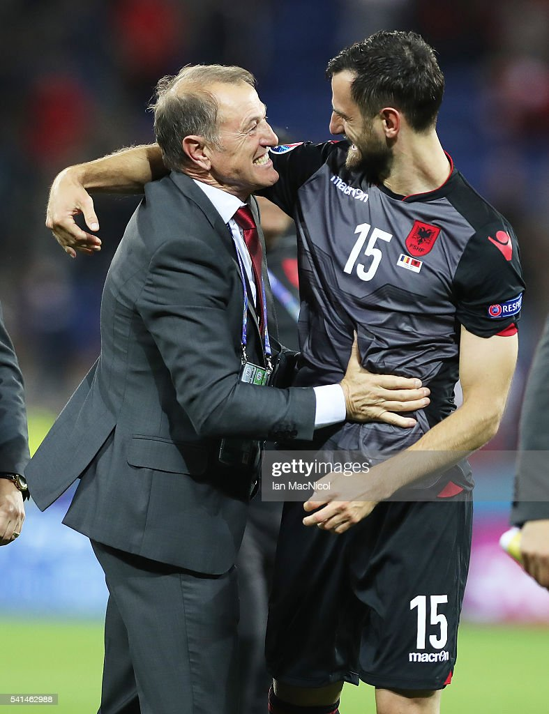 Alabainias manager Gianni De Bias celebrates with Mergim Mavraj of Albania at full time during the UEFA EURO 2016 Group A match between Romania and Albania at Stade des Lumieres on June 19, 2016 in Lyon, France.