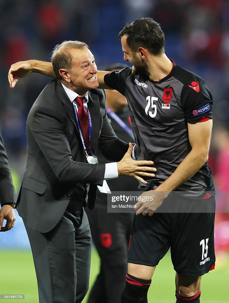 Alabainia's manager Gianni De Bias celebrates with Mergim Mavraj of Albania at full time during the UEFA EURO 2016 Group A match between Romania and Albania at Stade des Lumieres on June 19, 2016 in Lyon, France.