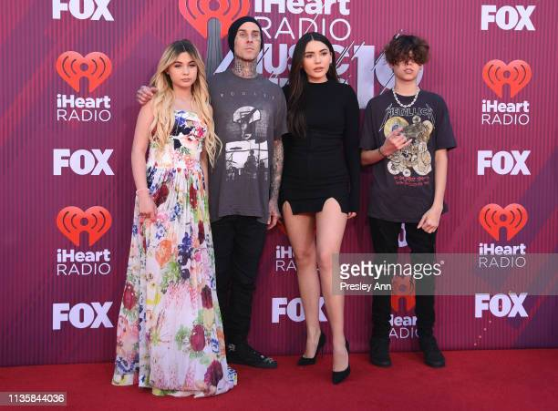 Alabama Barker Travis Barker Atiana De La Hoya and guest attend the 2019 iHeartRadio Music Awards which broadcasted live on FOX at Microsoft Theater...