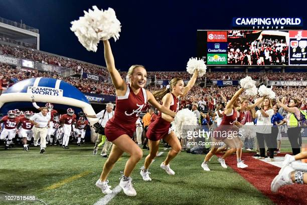 Alabama cheerleaders lead the team onto the field prior to the first half of the Camping World Kickoff game between the Alabama Crimson Tide and the...