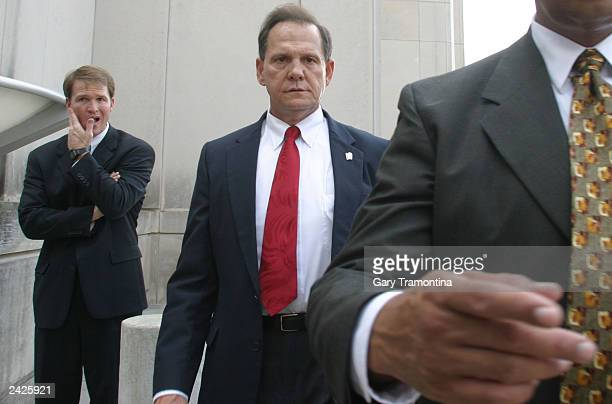 Alabama Chief Justice Roy Moore leaves a news conference at the State Judicial building August 25 2003 in Montgomery Alabama Moore is currently...