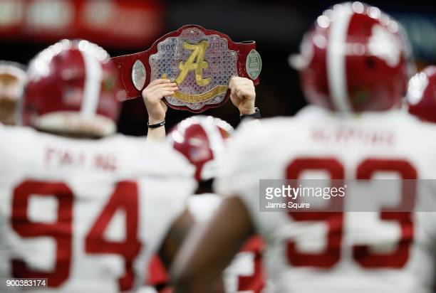 Alabama Crimson Tide celebrates with a belt in the second half of the AllState Sugar Bowl against the Clemson Tigers at the MercedesBenz Superdome on...
