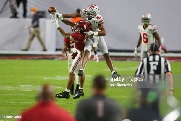 Alabama Crimson Tide defensive back Brian Branch defends a pass intended for Ohio State Buckeyes wide receiver Garrett Wilson during the CFP National...