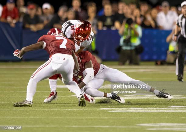 Alabama Crimson Tide defensive back Trevon Diggs makes a tackle n Louisville Cardinals wide receiver Keion Wakefield during the football game between...