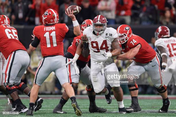 Alabama Crimson Tide defensive lineman Da'Ron Payne looks to tackle Georgia Bulldogs quarterback Jake Fromm during the College Football Playoff...
