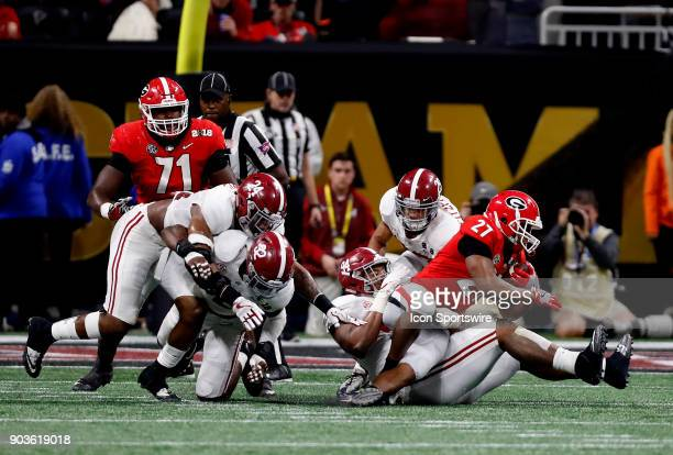 Alabama Crimson Tide defensive linemen Da'Ron Payne tackles Georgia Bulldogs running back Nick Chubb during the College Football Playoff National...
