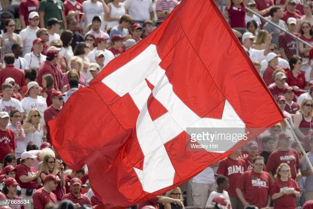 Alabama Crimson Tide flag is flown around the stadium during a 24 to 13 win over the Arkansas Razorbacks on September 24, 2005 at Bryant-Denny...