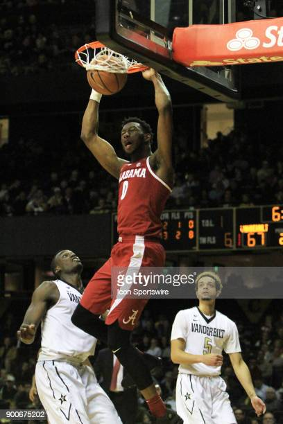 Alabama Crimson Tide forward Donta Hall dunks over Vanderbilt Commodores forward Djery Baptiste in the second half of a Southeastern Conference game...