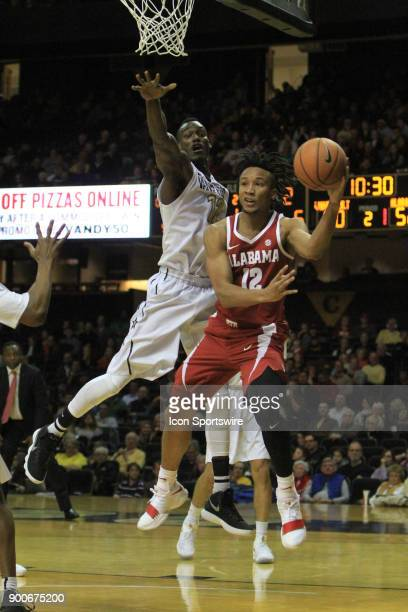 Alabama Crimson Tide guard Dazon Ingram passes the ball underneath the basket in the second half of a Southeastern Conference game between the...