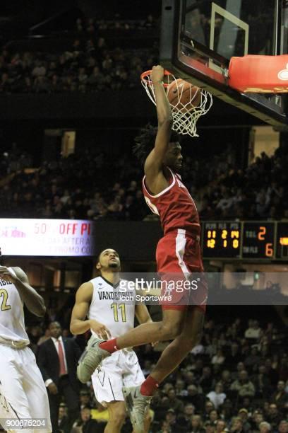 Alabama Crimson Tide guard Herbert Jones drives for a dunk past Vanderbilt Commodores defender Jeff Roberson in the second half of a Southeastern...