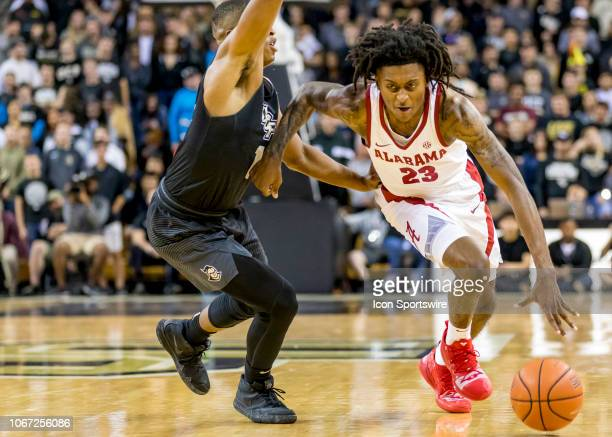 Alabama Crimson Tide guard John Petty dribbles around UCF Knights guard BJ Taylor during the basketball game between the UCF Knights and the and...