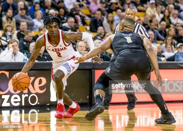 Alabama Crimson Tide guard Kira Lewis Jr looks to drive to the basket during the basketball game between the UCF Knights and the and Alabama Crimson...