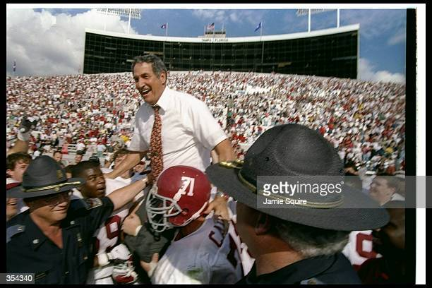 Alabama Crimson Tide head coach Gene Stallings celebrates after the Outback Bowl against the Michigan Wolverines in Tampa, Florida. Alabama won the...