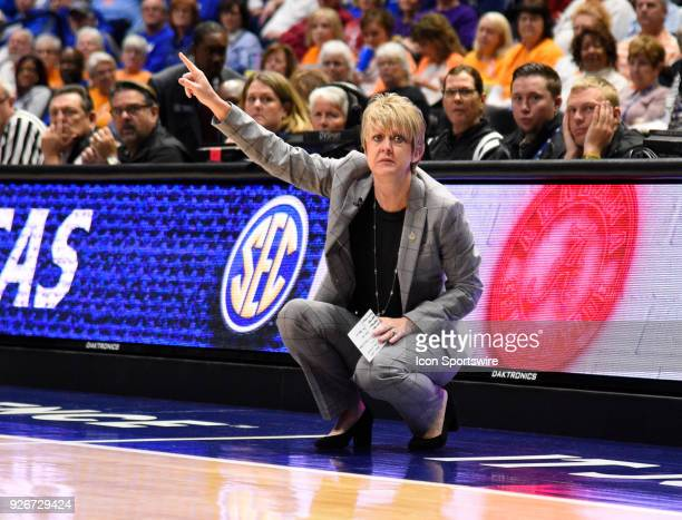 Alabama Crimson Tide head coach Kristy Curry point to the shot clock during the first half between the Alabama Crimson Tide versus the Kentucky...