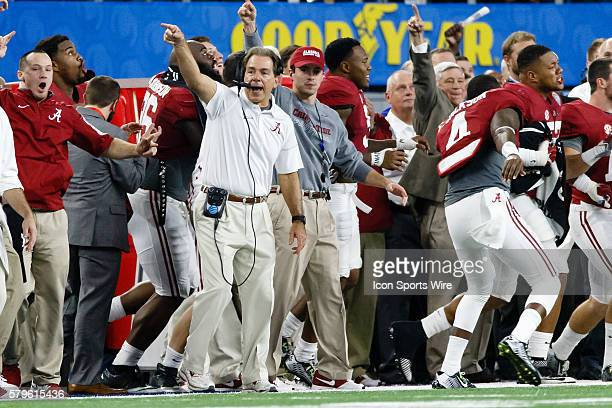 Alabama Crimson Tide head coach Nick Saban points the other way after an interception during the NCAA College Football Playoff Semifinal - Cotton...
