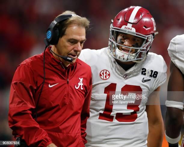 Alabama Crimson Tide head coach Nick Saban speaks with quarterback Tua Tagovailoa during the College Football Playoff National Championship Game...