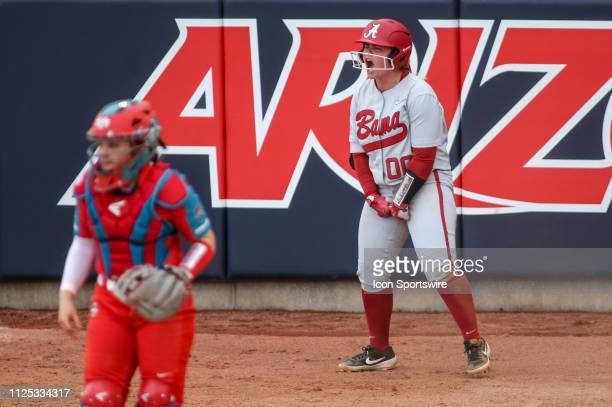 Alabama Crimson Tide infielder Maddie Morgan celebrates scoring a run during a college softball game between the Alabama Crimson Tide and the New...