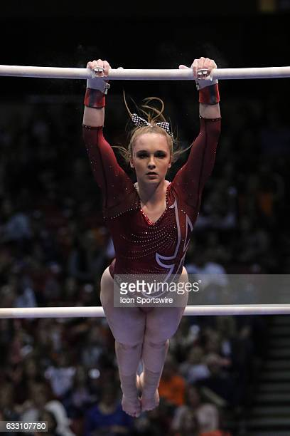 Alabama Crimson Tide Keely McNeer on the uneven bars at the Elevate the Stage Meet between the Auburn Tigers and the Alabama Crimson Tide Alabama...