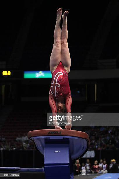 Alabama Crimson Tide Keely McNeer peforms a vault at the Elevate the Stage Meet between the Auburn Tigers and the Alabama Crimson Tide Alabama...