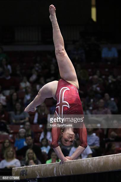 Alabama Crimson Tide Keely McNeer performs on the balance beam at the Elevate the Stage Meet between the Auburn Tigers and the Alabama Crimson Tide...
