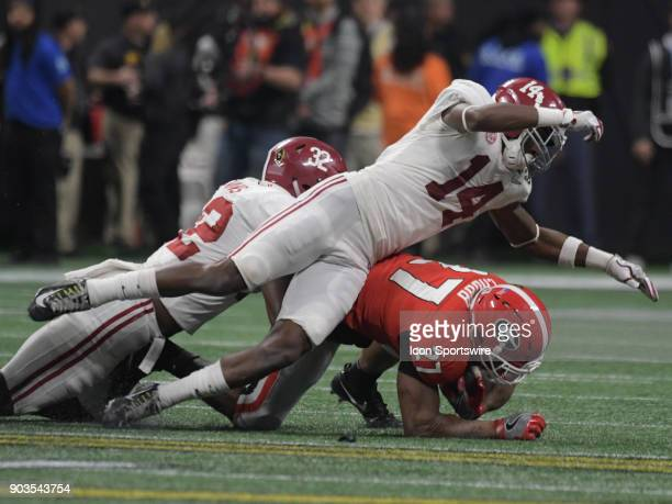 Alabama Crimson Tide linebacker Rashaan Evans and Alabama Crimson Tide defensive back Deionte Thompson tackle Georgia Bulldogs running back Nick...