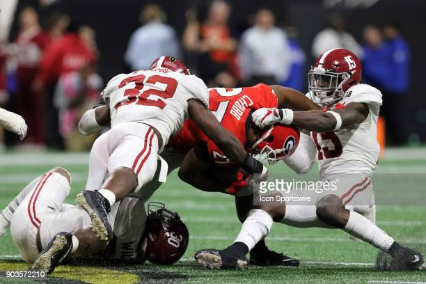 Alabama Crimson Tide linebacker Rashaan Evans and Alabama Crimson Tide defensive back Ronnie Harrison tackle Georgia Bulldogs running back Nick Chubb...
